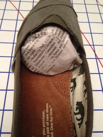papier journal chaussures mouillées